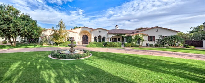 Ivan Osorio, a neurologist practicing in Kansas City, and his wife Sheryl, purchased an 8,600-square-foot mansion in Scottsdale's Paradise Valley Farms community.
