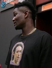 Deandre Ayton wore a T-shirt with former Suns great, two-time NBA MVP Steve Nash's face on it after Monday's preseason opener against the Sacramento Kings.