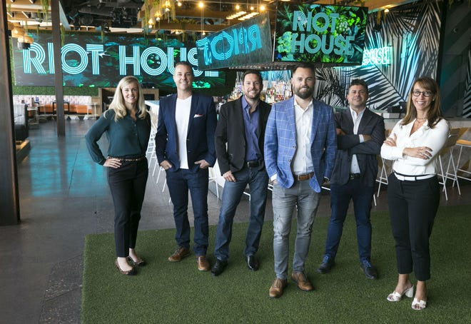 The Riot House Hospitality Group general counsel Alicia Casale (from left), COO Justin Cohen, President Jon Wright, CEO Ryan Hibbert, President Mike Troyan and CFO Leslie Schreiner at Riot House headquarters in Scottsdale on Sept. 18, 2018.