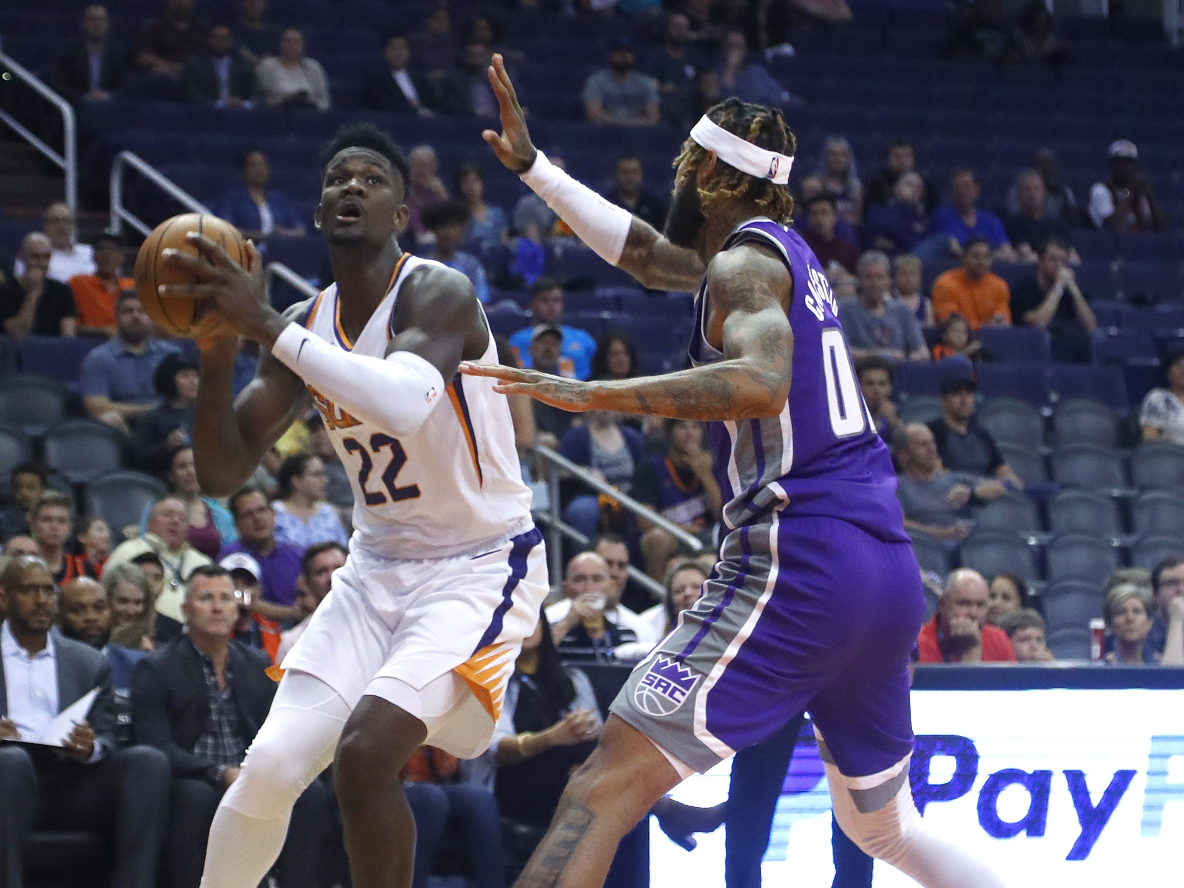 Suns' Deandre Ayton (22) pump fakes against Kings' Willie Cauley-Stein (00) during the first half at Talking Stick Resort Arena in Phoenix, Ariz. on October 1, 2018.
