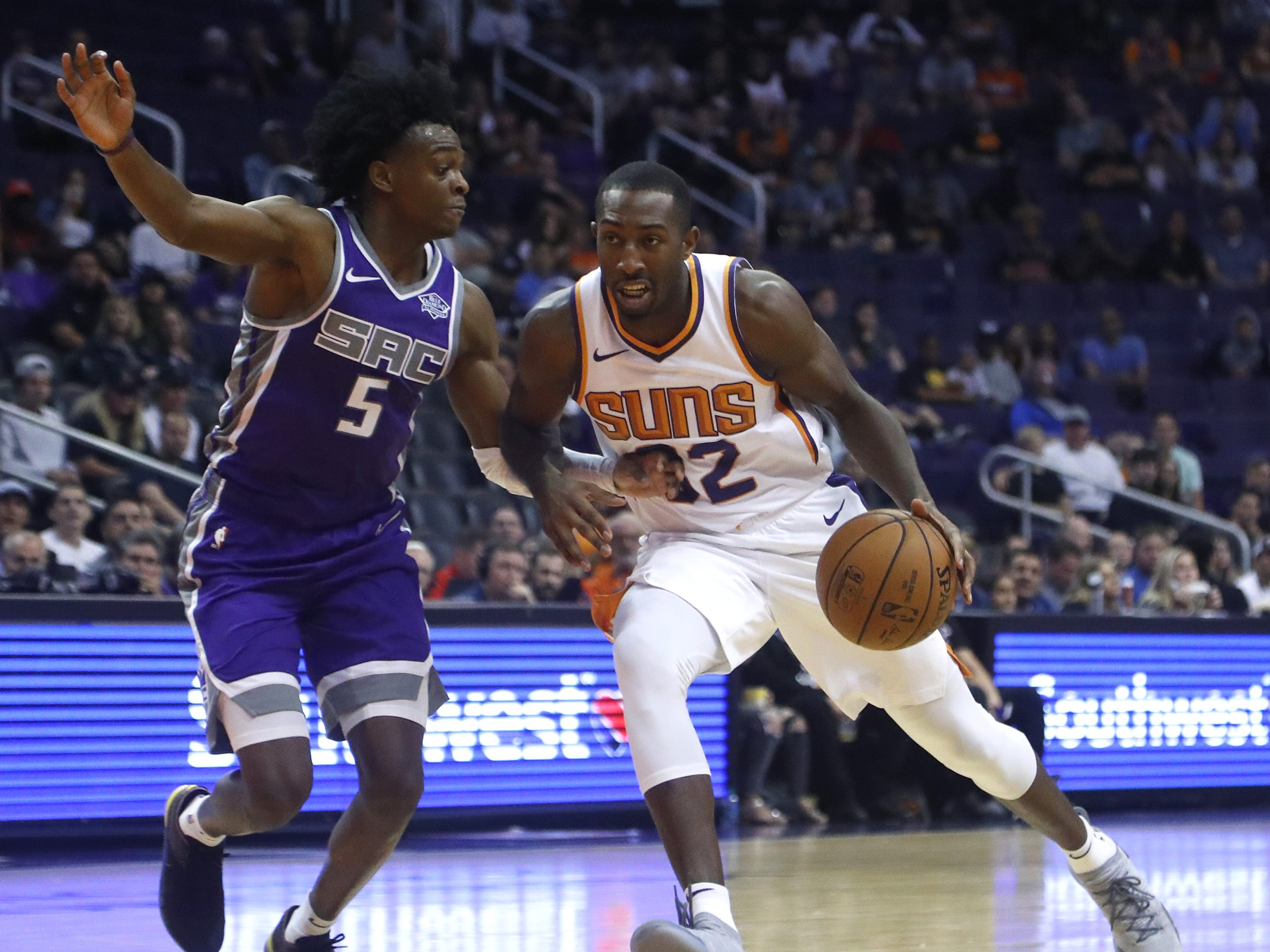 Suns' Davon Reed drives against Kings' De'Aaron Fox (5) during the first half at Talking Stick Resort Arena in Phoenix, Ariz. on October 1, 2018.
