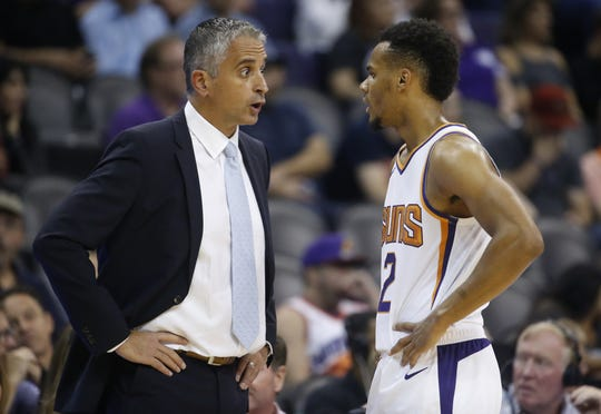 Suns head coach Igor Kokoskov talks with Elie Okobo (2)  during the first half at Talking Stick Resort Arena in Phoenix, Ariz. on October 1, 2018.