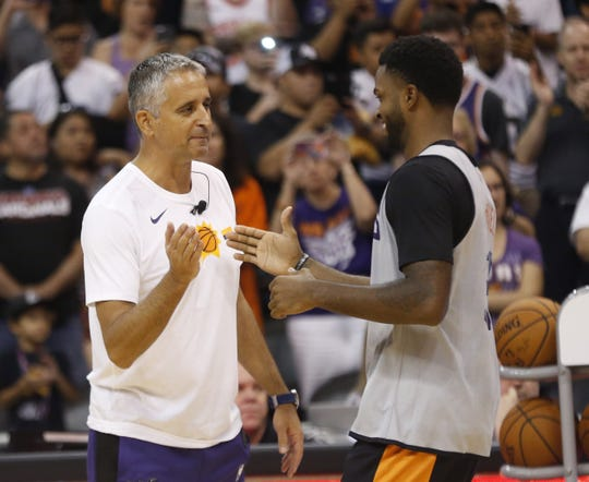 Suns head coach Igor Kokoskov high-fives Troy Daniels during an Open Practice at Talking Stick Resort Arena in Phoenix, Ariz. on Sept. 29, 2018.