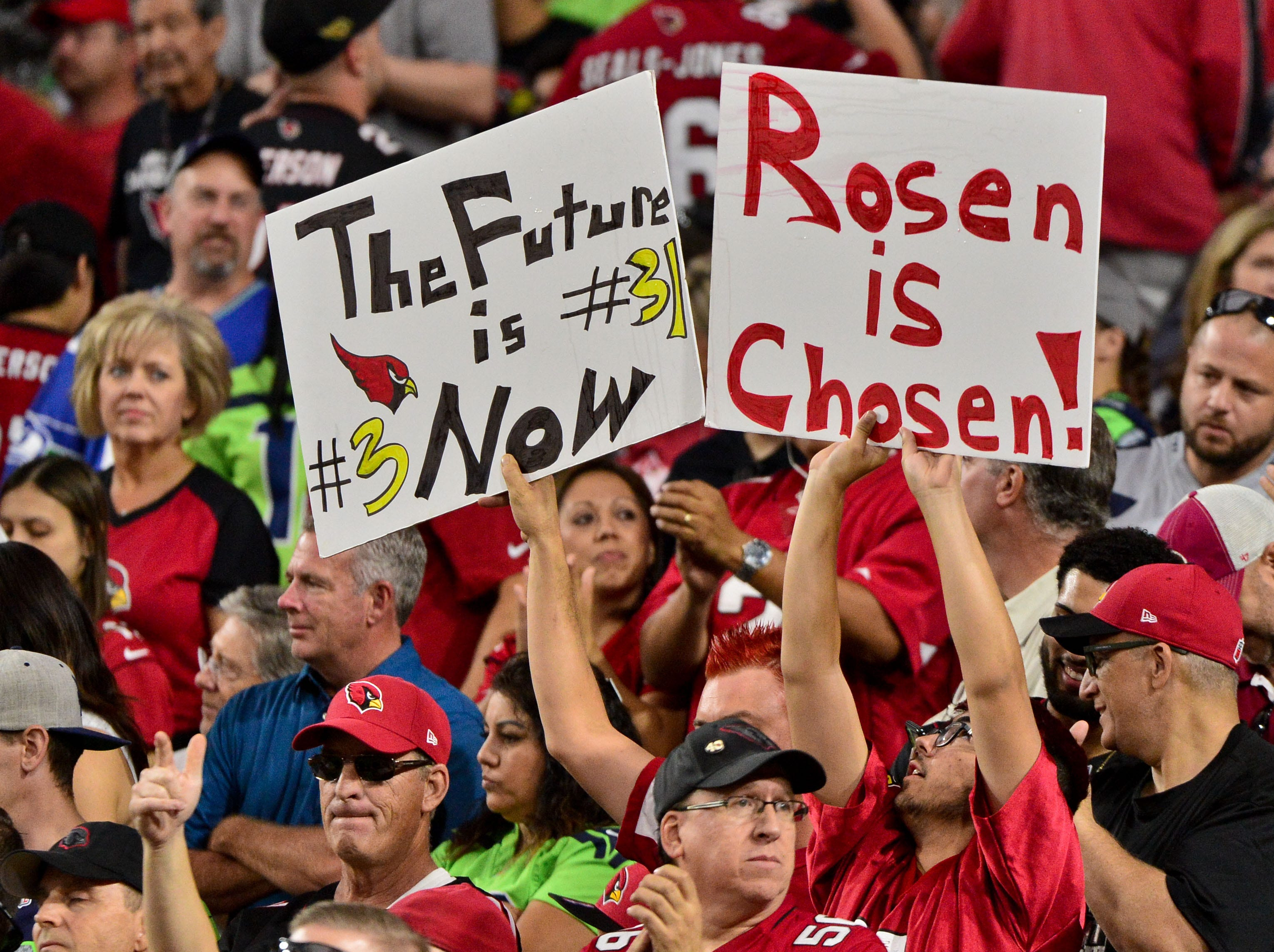 Fans hold signs in support of Arizona Cardinals quarterback Josh Rosen during the game against the Seattle Seahawks on Sept. 30, 2018 at State Farm Stadium.