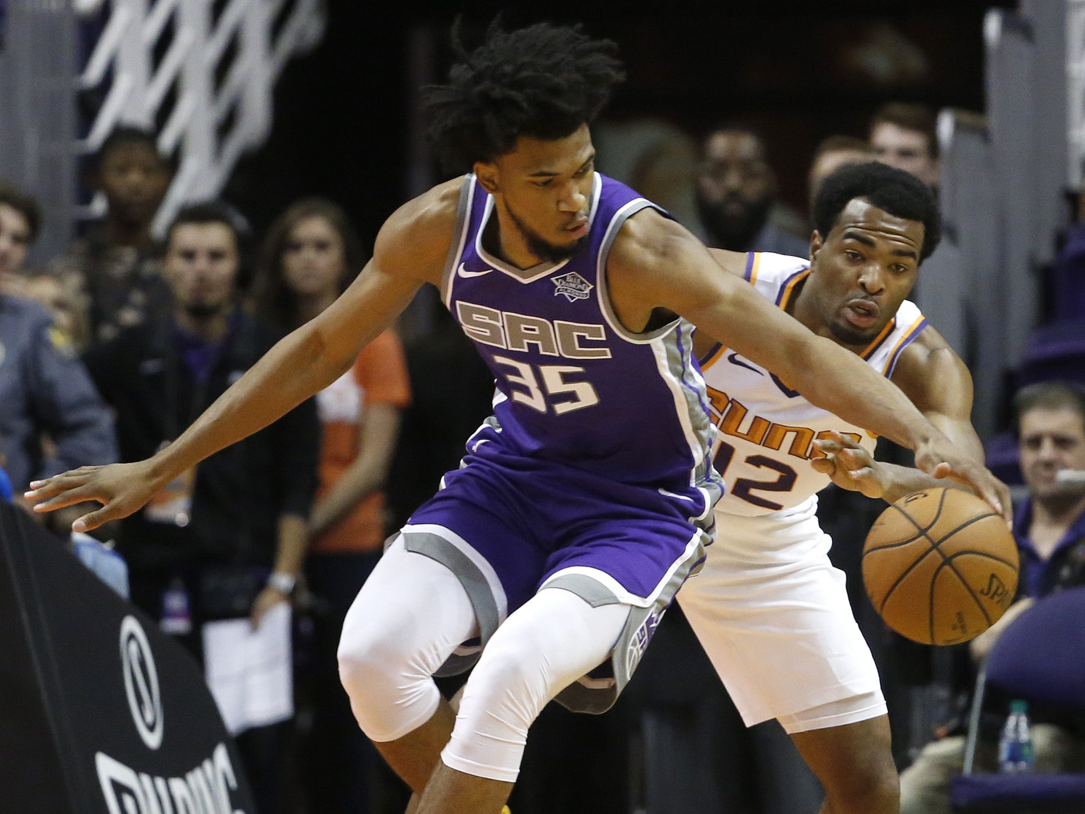 Suns TJ Warren (12) defends Kings Marvin Bagley III (35) during the first half at Talking Stick Resort Arena in Phoenix, Ariz. on October 1, 2018.