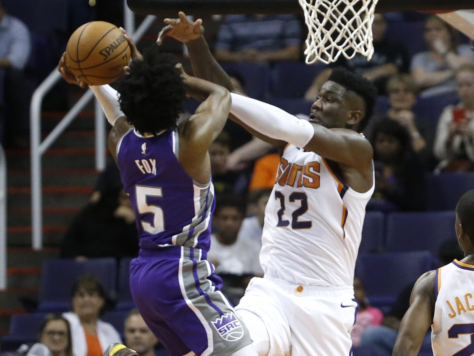 Suns' Deandre Ayton (22) blocks a shot on Kings' De'Aaron Fox (5) during the first half at Talking Stick Resort Arena in Phoenix, Ariz. on October 1, 2018.