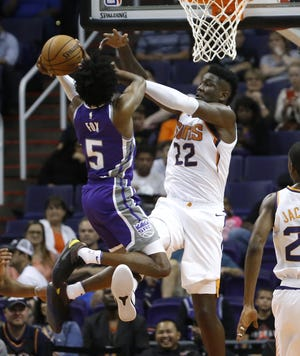 Suns rookie Deandre Ayton blocks a shot from Kings guard De'Aaron Fox during the first half of a game Oct. 1 at Talking Stick Resort Arena.