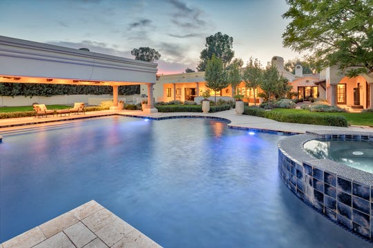 The back yard features a resort style 55-foot salt water lap pool with a jetted hot tub.
