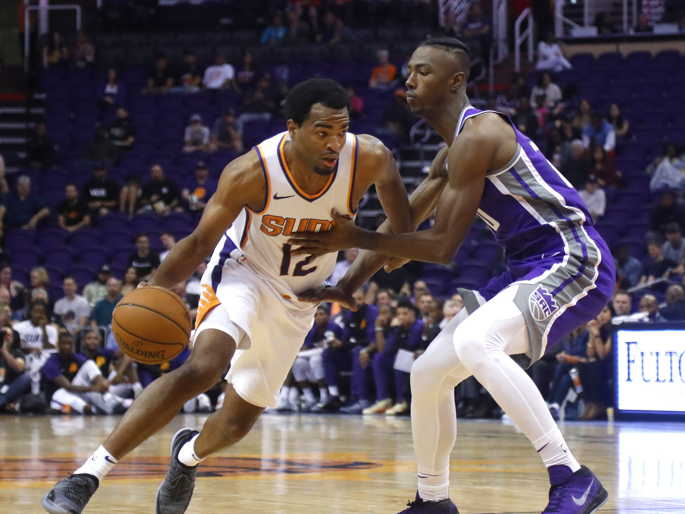 Suns' T.J. Warren (12) drives against Kings' Harry Giles III (20) during the second half at Talking Stick Resort Arena in Phoenix, Ariz. on October 1, 2018.