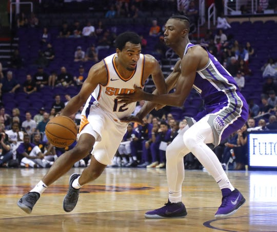 Suns' TJ Warren (12) drives against Kings' Harry Giles III (20) during the second half at Talking Stick Resort Arena in Phoenix, Ariz. on October 1, 2018.
