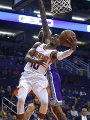 Suns point guard Shaquille Harrison tries to make a layup past the Kings' Willie Cauley-Stein on Oct. 1.