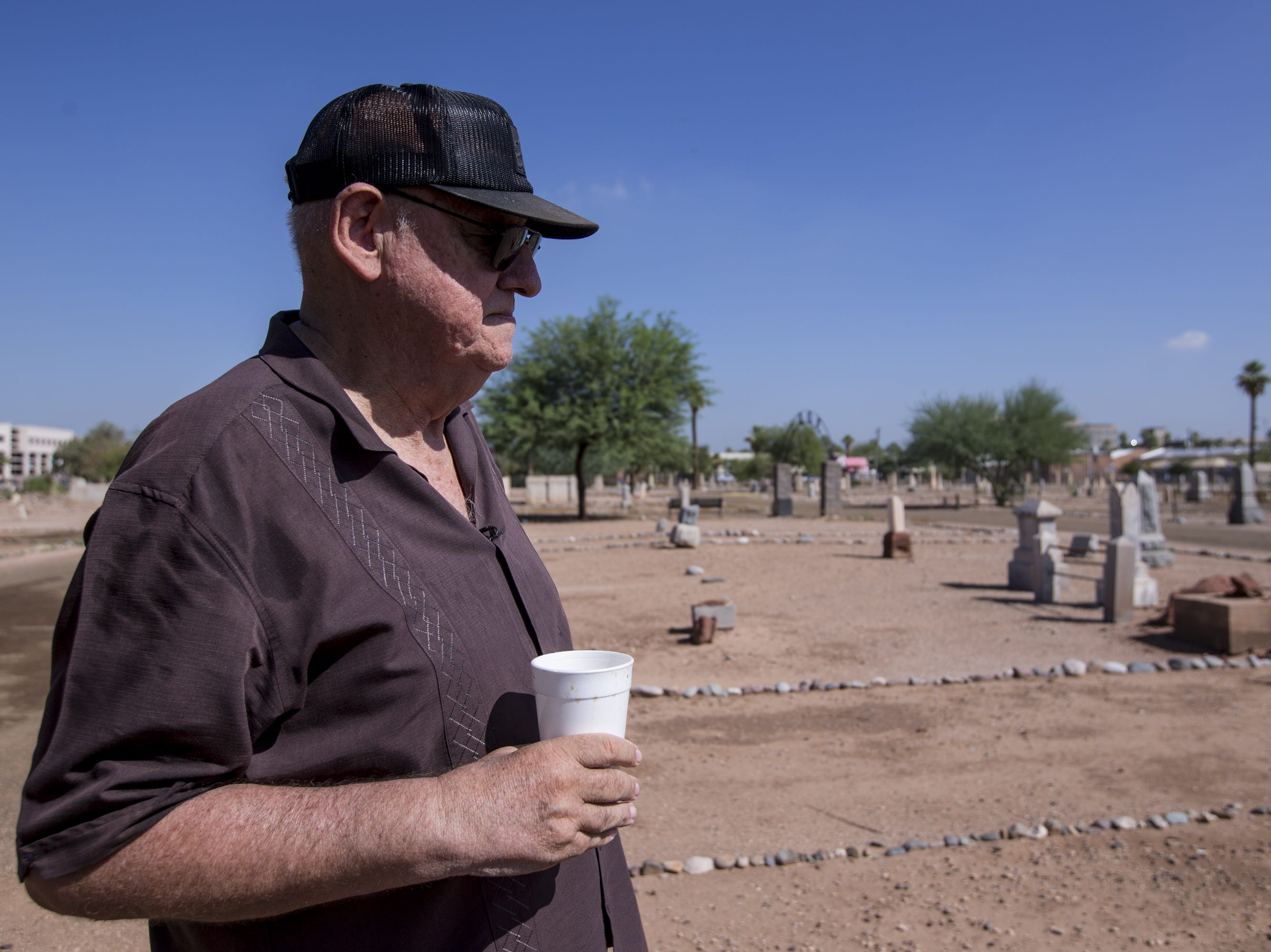 Frank Barrios is pictured on Sept. 20, 2018, at Pioneer & Military Memorial Park in Phoenix. Some of the headstones from the historic Sotelo-Heard Cemetery have been moved to their current location to prevent vandalism.