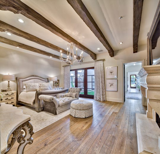 The master suite has a marble bathroom, private hair salon, a woman's walk-in closet with a separate shoe room and designer cabinetry.