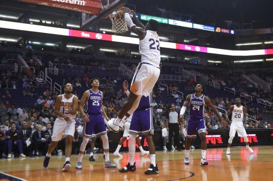Suns' Deadre Ayton (22) dunks against the Kings during the first half at Talking Stick Resort Arena in Phoenix, Ariz. on October 1, 2018.