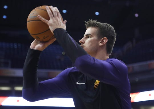 Dragan Bender warms up before a preseason game against the Kings on Oct. 1 at Talking Stick Resort Arena.