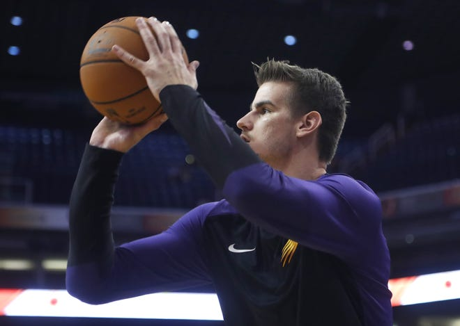 Dragan Bender warms up before a preseason game against the Kings at Talking Stick Resort Arena on Oct. 1.