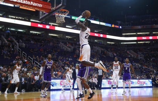 Deandre Ayton dunks the ball during a preseason game Monday against the Sacramento Kings at Talking Stick Resort Arena.