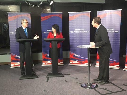 Candidates for Arizona treasurer, Democrat Mark Manoil and Republican Kimberly Yee, debate on Oct. 1, 2018.
