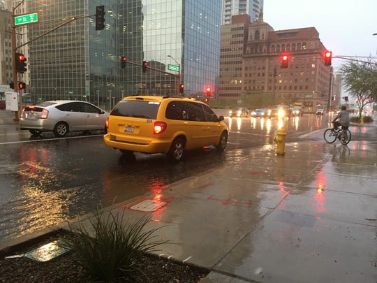 Rain falls on downtown Phoenix at the intersection of 1st Street and Van Buren Street the morning of Oct. 2, 2018.
