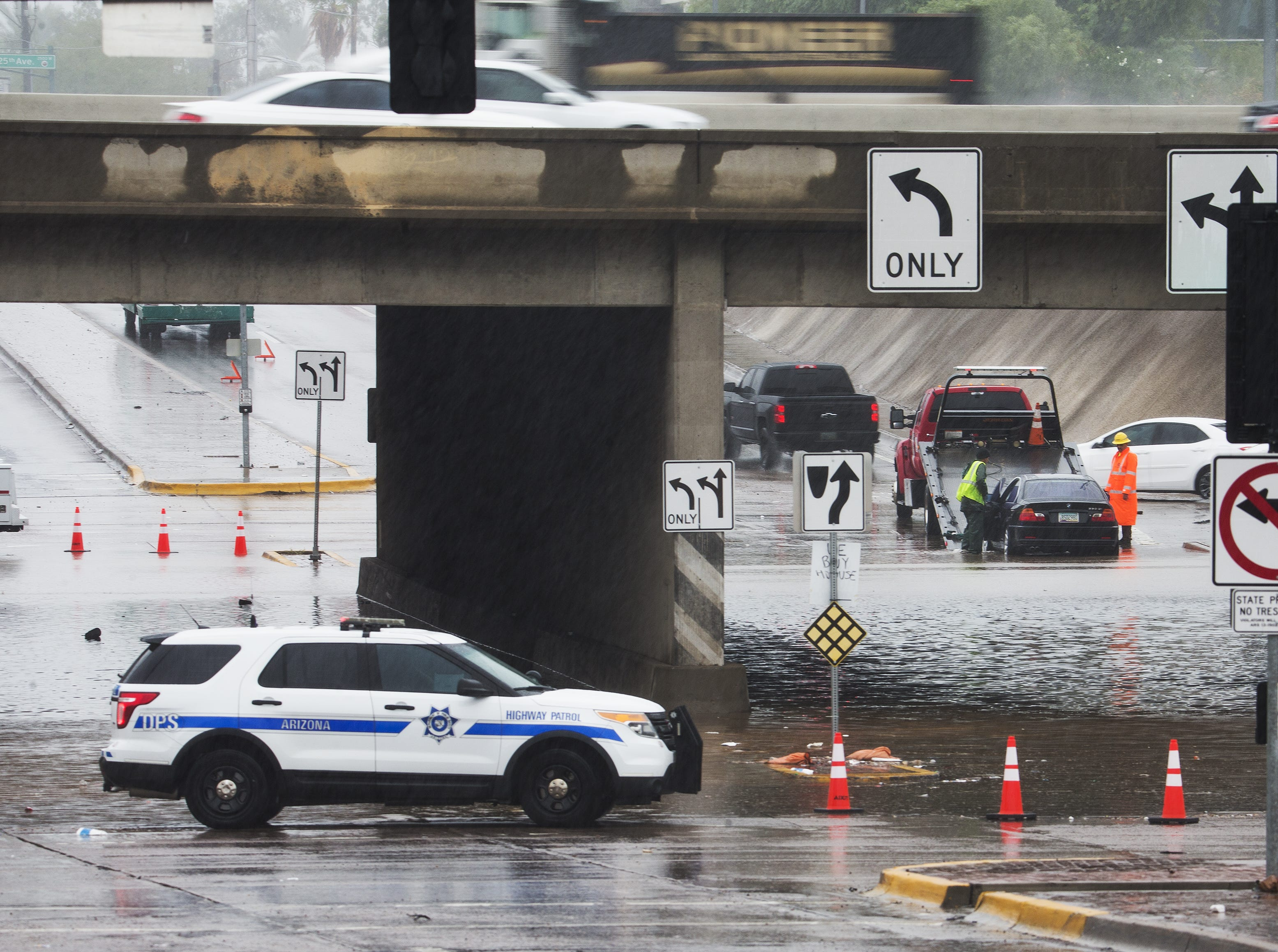 The Peoria Avenue underpass at I-17 in Phoenix is closed due to flooding, Tuesday morning, Oct. 2, 2018.