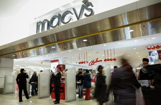 NEWPORT, NJ - NOVEMBER 27: People enter the Macy's store at the Newport Mall on November 27, 2014 in Jersey City, New Jersey. Black Friday sales, which now begin on the Thursday of Thanksgiving, continue to draw shoppers out for deals and sales. (Photo by Kena Betancur/Getty Images)