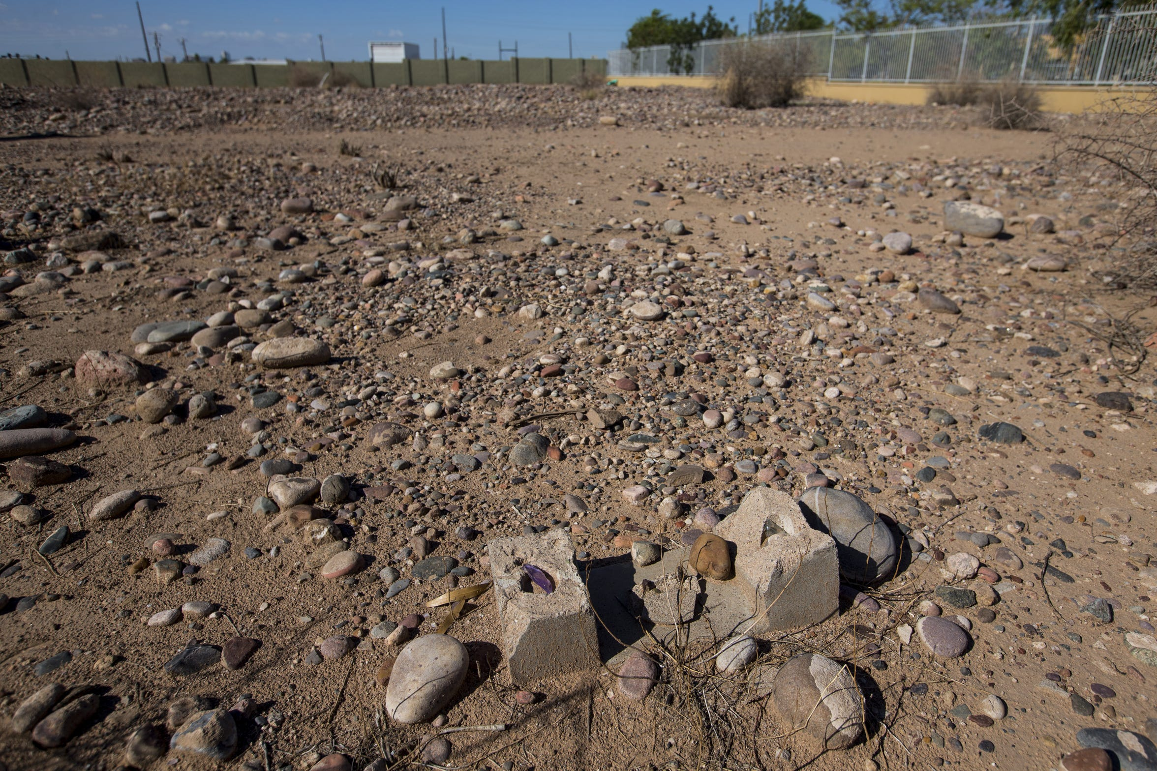 The grave from which an iron cross was stolen is pictured Sept. 20, 2018, at Sotelo-Heard Cemetery in Phoenix. Some headstones from the historic cemetery have been moved to their current location to prevent vandalization.