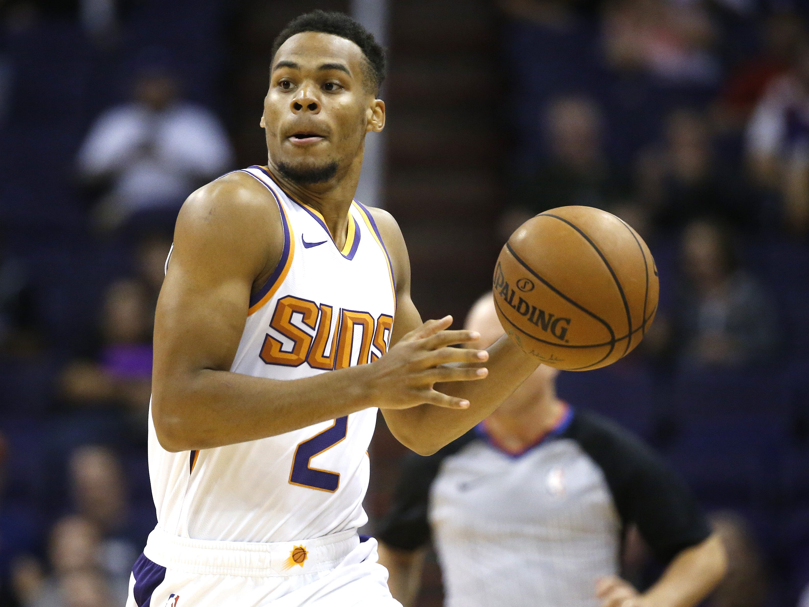 Suns Elie Okobo (2) dribbles up the court against the Kings during the first half at Talking Stick Resort Arena in Phoenix, Ariz. on October 1, 2018.