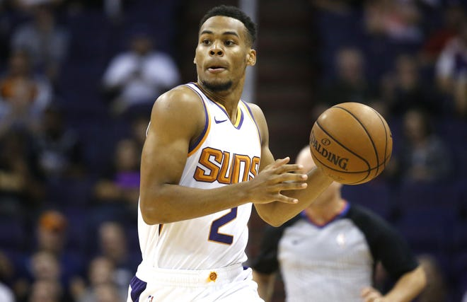 Phoenix Suns point guard Elie Okobo (2) dribbles to begin a play on offense against the Sacramento Kings at Talking Stick Resort Arena in Phoenix, Ariz. on October 1, 2018.