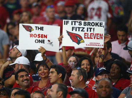 Fans hold signs in support of Arizona Cardinals quarterback Josh Rosen and wide receiver Larry Fitzgerald during the game against the Seattle Seahawks on Sept. 30, 2018 at State Farm Stadium.