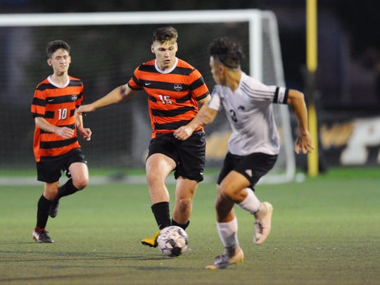 Noah Reitz (15) of Palmyra moves the ball up the field past Donovin Medina (3) from CD East during the first half of play Monday Oct.1,2018.