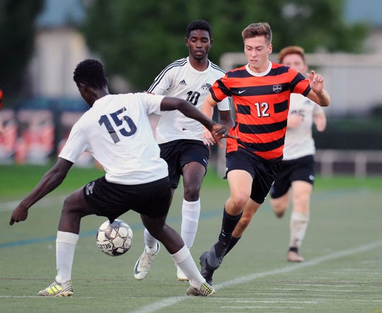 Alec Haldenman (12) of Palmyra tries to get the ball away from CD East's Abdoul Issoufou (15)  during the first half of play Monday Oct.1,2018.