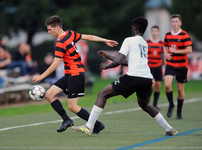 Michael Giordano (6) of Palmyra tries to move around CD East defender Abdoul Issoufou (15) during the first half of play Monday Oct.1,2018.