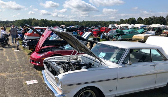 People wander around the second annual Stormville Airport Food Truck and Craft Beer Festival. There were around 21 food trucks and 61 vendors selling items like crafts and a car show hosted by Don Clady was put on Saturday as part of the second annual Festival.