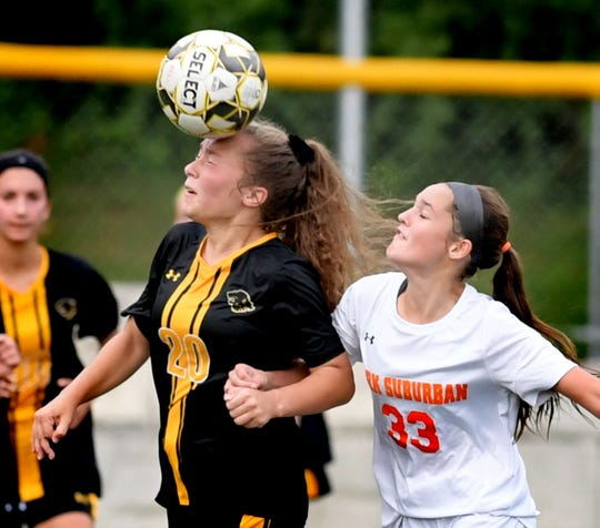 Red Lion's Shaye Robertson and York Suburban's Brooke Sargen vie for control during soccer action at Red Lion Tuesday, Oct. 2, 2018. Red Lion won 5-0. Bill Kalina photo