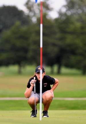 Central York's Cailey Roman lines up a putt during the PIAA District 3 Championship Golf match at Briarwood Golf Course, Tuesday, Oct. 2, 2018. John A. Pavoncello photo