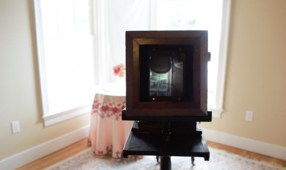 A look through the lens of a replica daguerreotype camera at the Goodridge Freedom Center. Subjects appear upside down through the lens as a combination of iodized-coated silver plates and mercury vapors were used to capture the photograph.