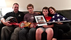 Watch: Family remembers Marine, athlete and son