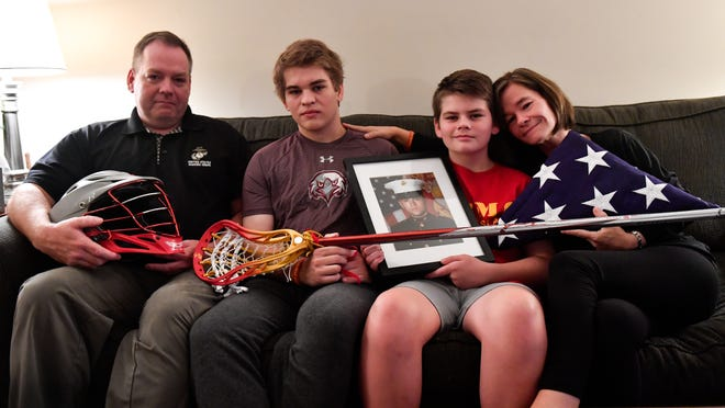 (Left to right) John, Liam, Aidan and Terry O'Connor share stories of Brendan's selflessness and impact on their lives.