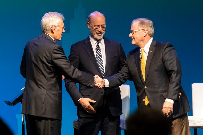Alex Trebek, who moderated the debate, shakes hands with republican challenger Scott Wagner, right, while incumbent Gov. Tom Wolf waits to shake hands. Both Wolf and Wagner were probably wondering, What just happened here?