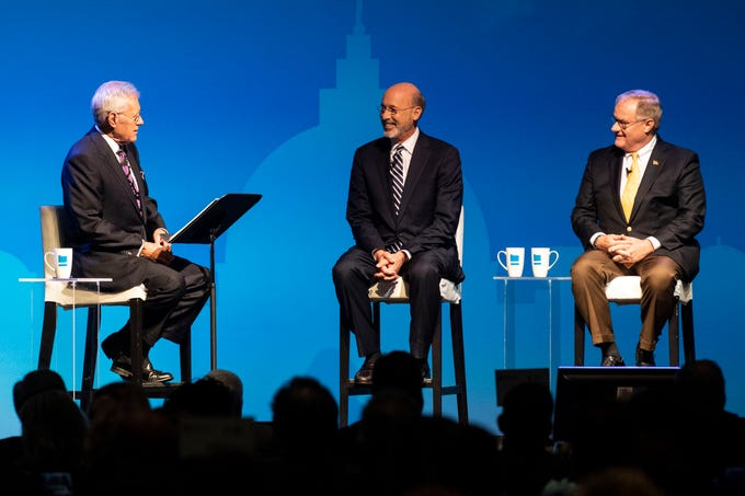 Alex Trebek, of Jeopardy!, left, speaks with incumbent Gov. Tom Wolf, middle, and Republican challenger and former State Sen. Scott Wagner during the gubernatorial debate at Hershey Lodge on Monday, Oct. 1, 2018.