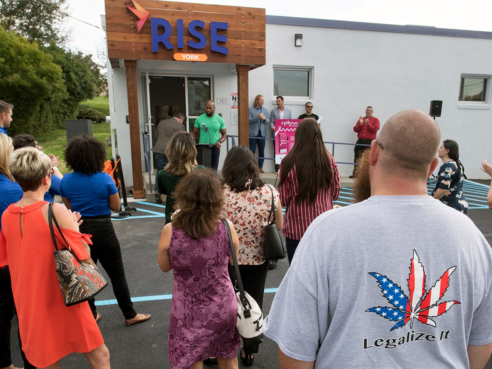 A crowd listens to speaker before a ribbon cutting in front of the Rise medical marijuana dispensary in West Manchester Township Tuesday October 2, 2018.