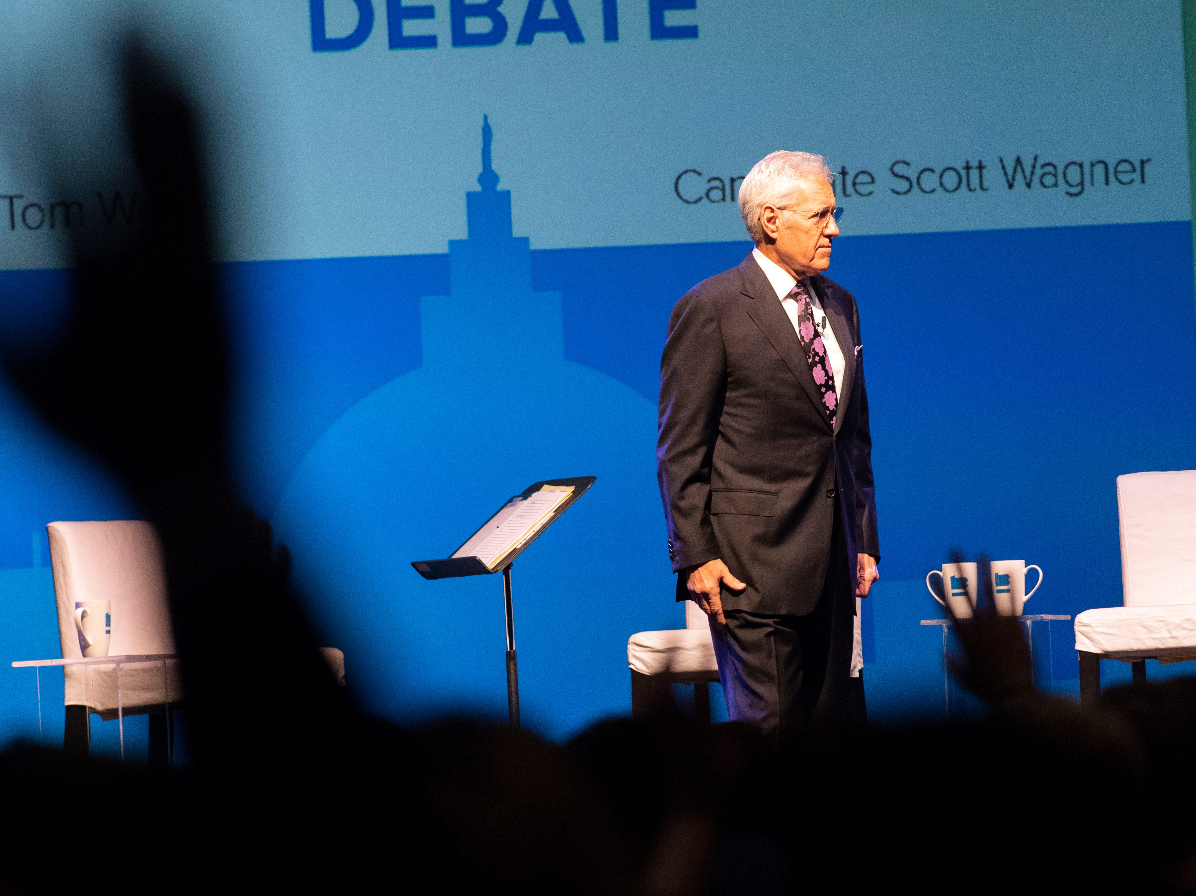 Debate moderator Alex Trebek, of Jeopardy!, asks the audience to raise their hands if they already know who they are voting for in the state Governor's race prior to the gubernatorial debate at Hershey Lodge on Monday, Oct. 1, 2018.