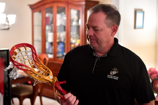 John O'Connor admires Brendan's lacrosse stick and the United States Marine Corps. engraving inside.