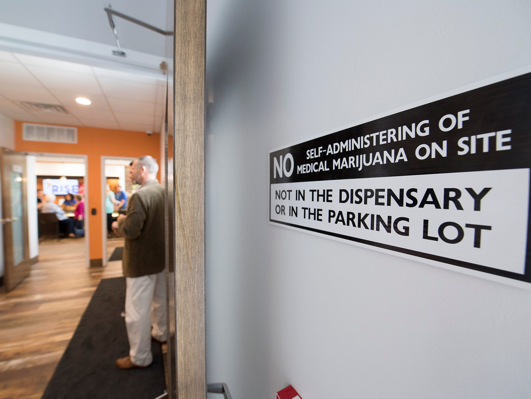 """A sign reads """"No administering of medical marijuana on site"""" in a secure entryway before entering the Rise medical marijuana dispensary waiting room in West Manchester Township."""