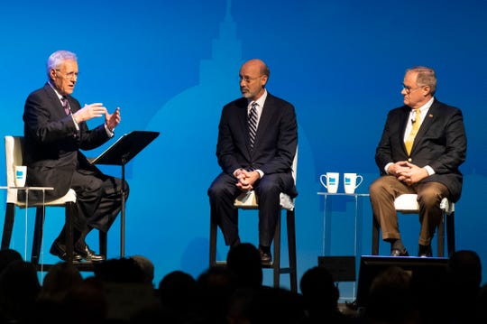 """Alex Trebek, of """"Jeopardy!,"""" left, speaks with incumbent Gov. Tom Wolf, middle, and Republican challenger and former State Sen. Scott Wagner during the gubernatorial debate at Hershey Lodge on Monday."""