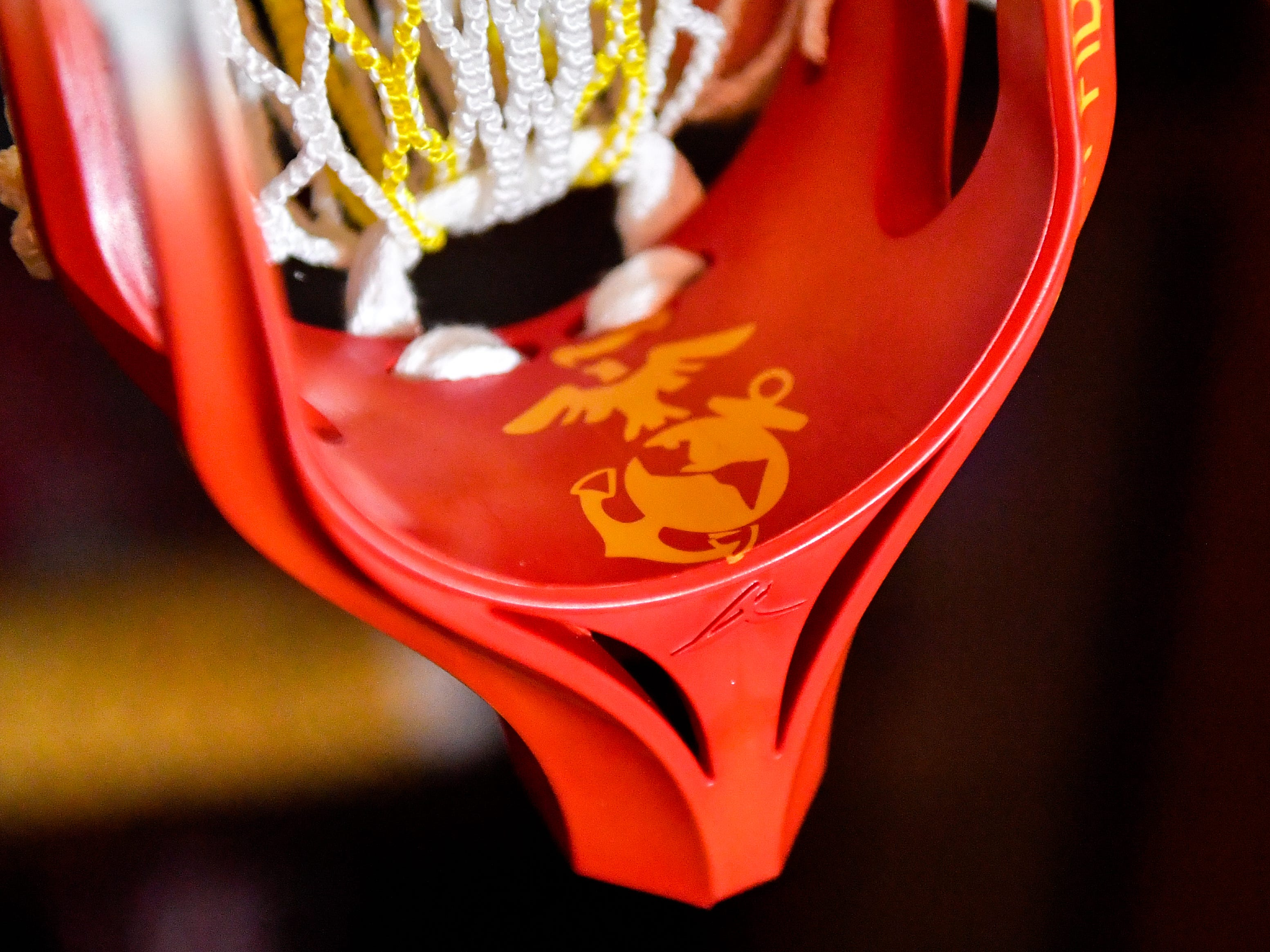 The United States Marine Corps. crest is engraved on the inside of Brendan O'Connor's lacrosse stick.