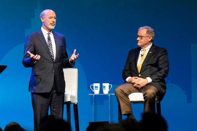 Democratic Gov. Tom Wolf, left, gives his closing remarks as Republican challenger Scott Wagner, right, listens, during the gubernatorial debate at Hershey Lodge on Monday, Oct. 1, 2018.