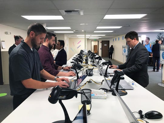 Several people use the terminals at the Healthy Nevada Project DNA Testing Facility in Reno on Oct. 2, 2018.