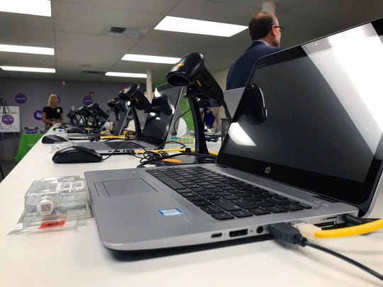 Several registration laptops and testing kits are lined up at the Healthy Nevada Project DNA Testing Facility in Reno on Oct. 2, 2018.