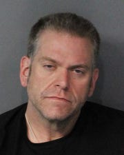 Sean Naughton, 41, was booked Oct. 1, 2018 into the Washoe County jail on a total of three charges.